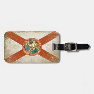 Etiqueta del equipaje con la bandera apenada de la etiquetas maletas
