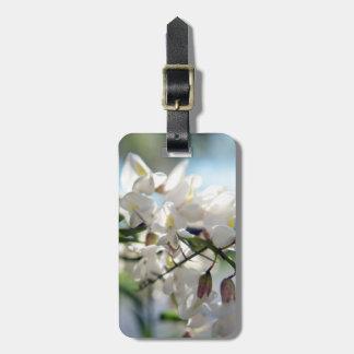 Etiqueta del equipaje con la foto de las flores etiquetas para maletas