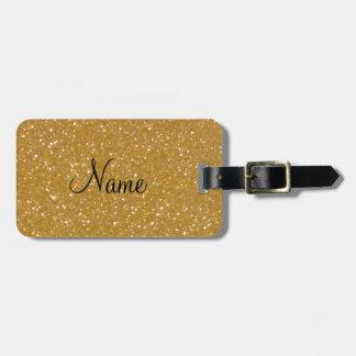 Etiqueta del equipaje del brillo del oro con etiqueta para maleta