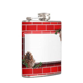 Etiqueta del navidad con el fondo del ladrillo
