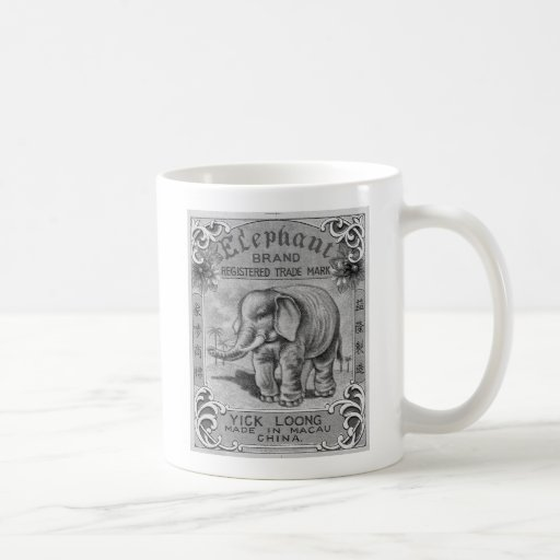 Etiqueta del petardo de la marca del elefante del  taza básica blanca