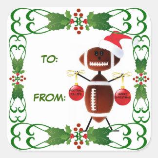 Etiqueta del regalo del fútbol del navidad