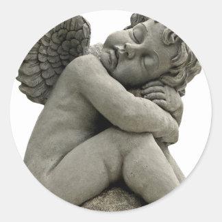 Etiqueta engomada redonda de la escultura del