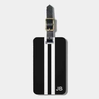 Etiqueta negra del equipaje del monograma con las etiqueta para maleta