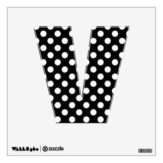 Etiqueta negra y blanca de la pared de la letra V
