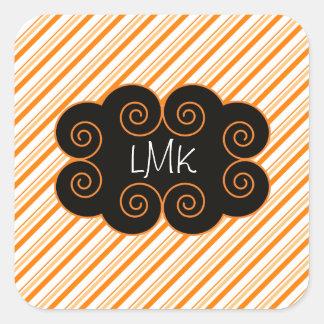Etiqueta rayada del naranja y blanca de Monogrammi