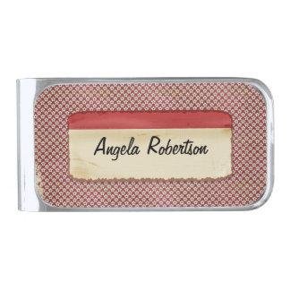 Etiqueta roja de estrella del fondo sucio rojo del clip para billetes plateado
