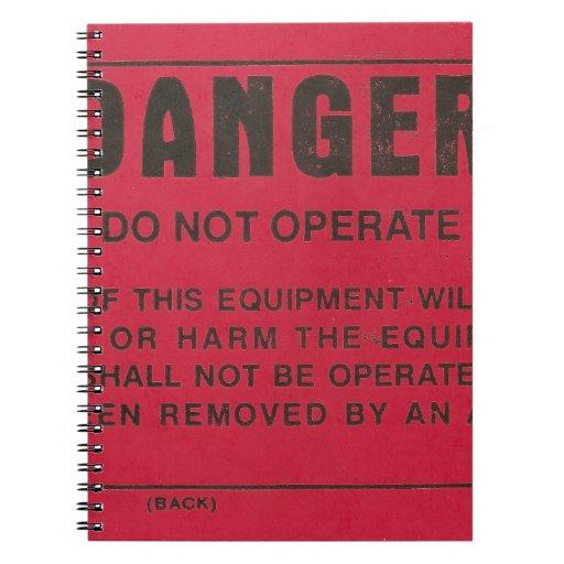 Etiqueta roja del peligro libreta
