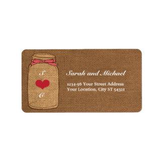 Etiqueta roja del tarro de albañil de la guinga y etiquetas de dirección