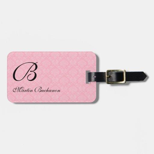 Etiqueta rosada con monograma del equipaje del etiqueta de equipaje
