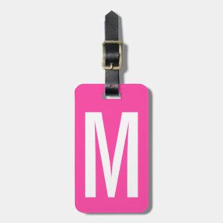 Etiqueta rosada de neón colorida del equipaje del