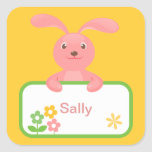 Etiqueta rosada del conejito y de la flor