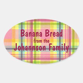 Etiqueta rosada y amarilla del tarro del pan de