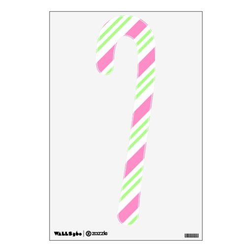 Etiqueta rosada y verde del bastón de caramelo de