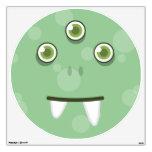 Etiqueta verde de la pared de la cara del monstruo