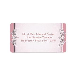 Etiquetas de dirección cruzadas rosadas de la flor