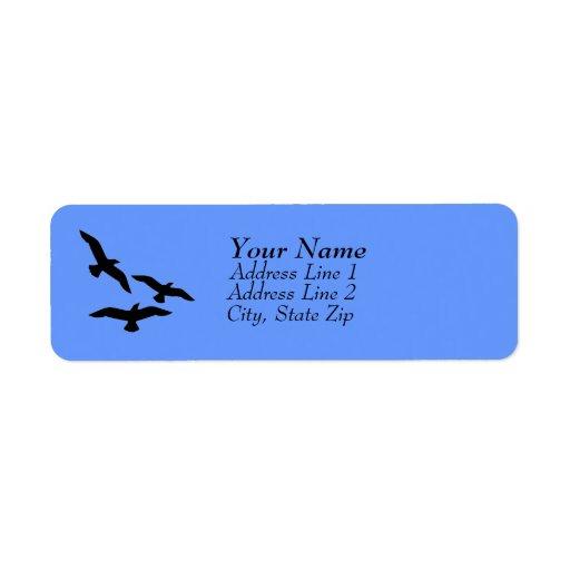 Etiquetas de dirección de los pájaros en vuelo