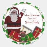 Etiquetas del navidad de Santa y de los presentes