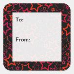 Etiquetas del regalo de las estrellas del rojo y pegatina cuadradas