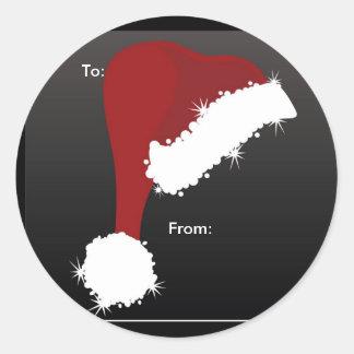Etiquetas del regalo del gorra de Santa