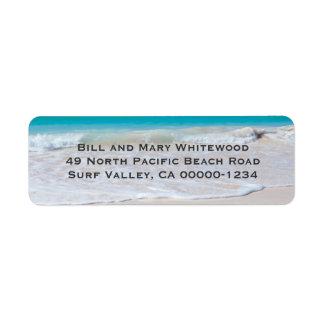 Etiquetas del remite de la arena del agua y de la etiqueta de remite