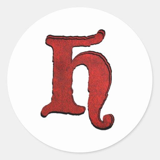 Etiquetas engomadas rubricadas fuente roja del pegatina redonda