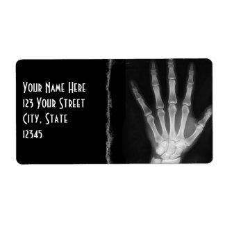Etiquetas esqueléticas del remite de la mano de la etiqueta de envío