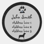 Etiquetas negras y grises de la pata del perro de etiqueta redonda