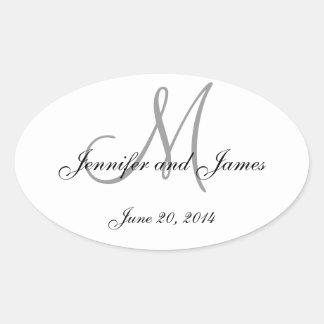 Etiquetas ovales del boda del monograma gris y pegatina ovalada