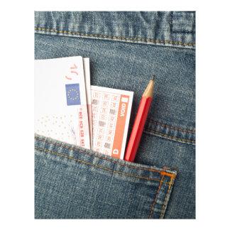 Euro money and lottery bet slip in pocket letterhead