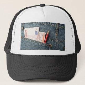 Euro money and lottery bet slip in pocket trucker hat