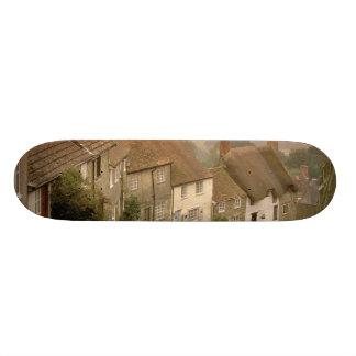 Europe, England, Dorset, Shaftesbury. Gold hill Skateboard Deck