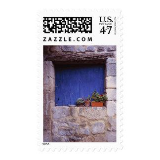 Europe, France, Cereste. A blue door adds color Postage
