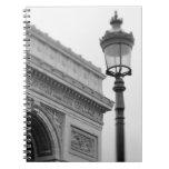 Europe, France, Paris. Arc de Triomphe and Notebook