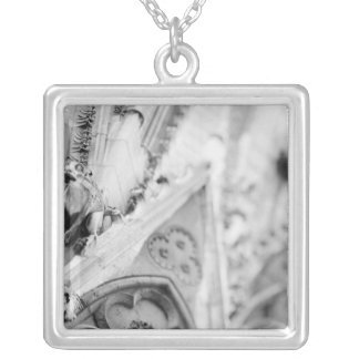 Europe, France, Paris. Detail: sculpture on Silver Plated Necklace
