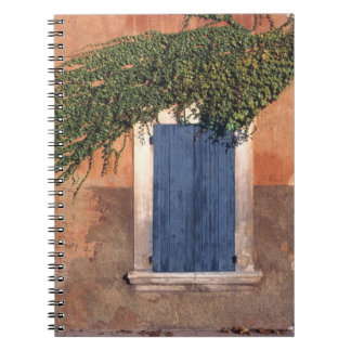 Europe, France, Roussillon. Ivy covers the wall Notebook