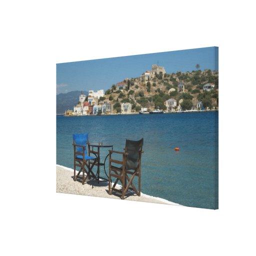 Europe, Greece, Kastellorizo: chairs on the edge Canvas Print