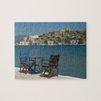 Europe, Greece, Kastellorizo: chairs on the edge Jigsaw Puzzle