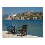 Europe, Greece, Kastellorizo: chairs on the edge Postcard