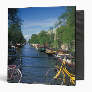 Europe, Holland, Amsterdam, yellow bicycle and 3 Ring Binder