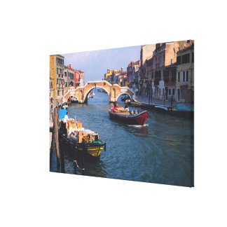 Europe, Italy, Venice. Boats bringing in Canvas Print