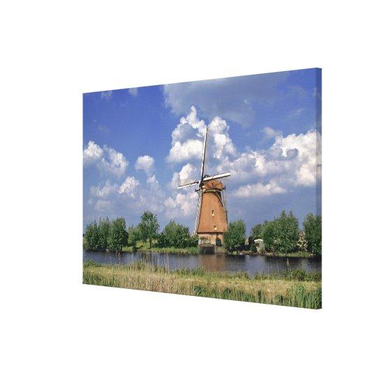Europe, Netherlands, Kinerdijk. A windmill sits Canvas Print
