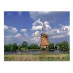 Europe, Netherlands, Kinerdijk. A windmill sits Postcard