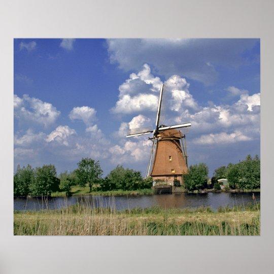 Europe, Netherlands, Kinerdijk. A windmill sits Poster