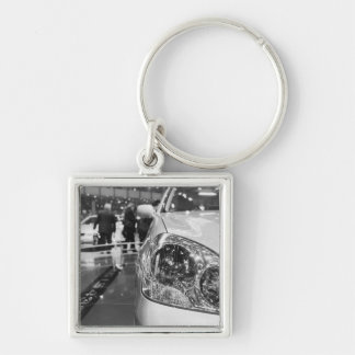 Europe, Switzerland, Geneva. Geneva Motor Show; 2 Silver-Colored Square Keychain