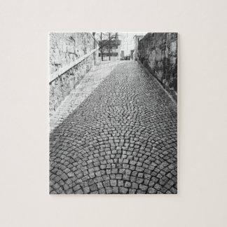 Europe, Switzerland, Zurich. Cobbled street, Puzzles