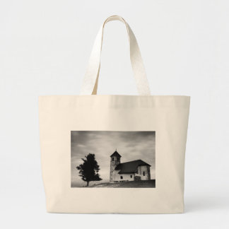 Evening cloud over church large tote bag
