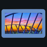 """Evening Delight No. 3 Magnet<br><div class=""""desc"""">Framed in blue is a stunning tropical sunset at sea,  as seen from the Sunwalk deck of the Enchantment of the Seas cruise ship.</div>"""