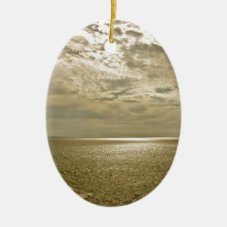 EVENING LIGHT WITH CLOUDY SKY AT THE OCEAN CERAMIC ORNAMENT