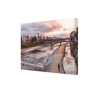 Evening walk along the Kamo River in Kyoto Canvas Print